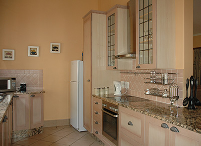 The kitchen is fully equipped with microwave, fridge/freezer and full stove, and all the utensils for modern living.