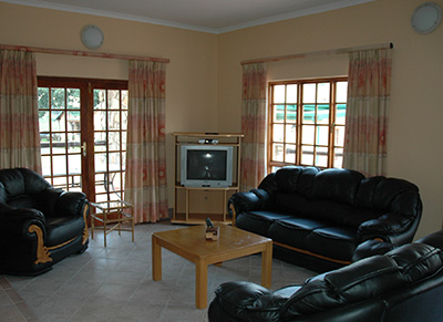 The spacious open plan lounge and dining area has a large fireplace to provide warmth after a days fishing.