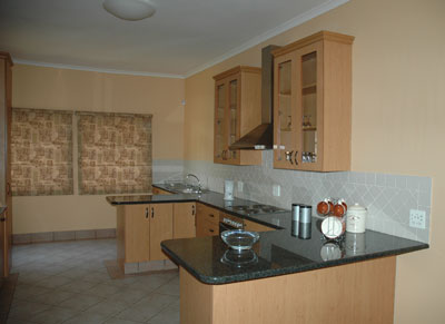 The large kitchen is fully equipped with microwave, fridge/freezer and full stove, and all the utensils allowing enough space for the family to join in the cooking