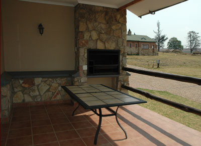 The covered patio, which has restricted view of the dam and koppie, has a built in braai and patio table and chairs and can be used for the family meals and is an ideal spot for sundowners.